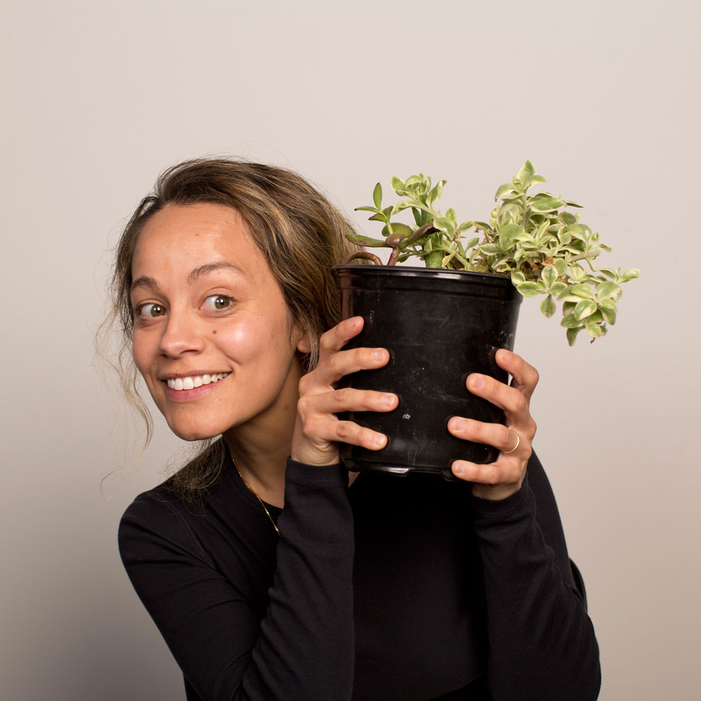 Jeannine holding a plant